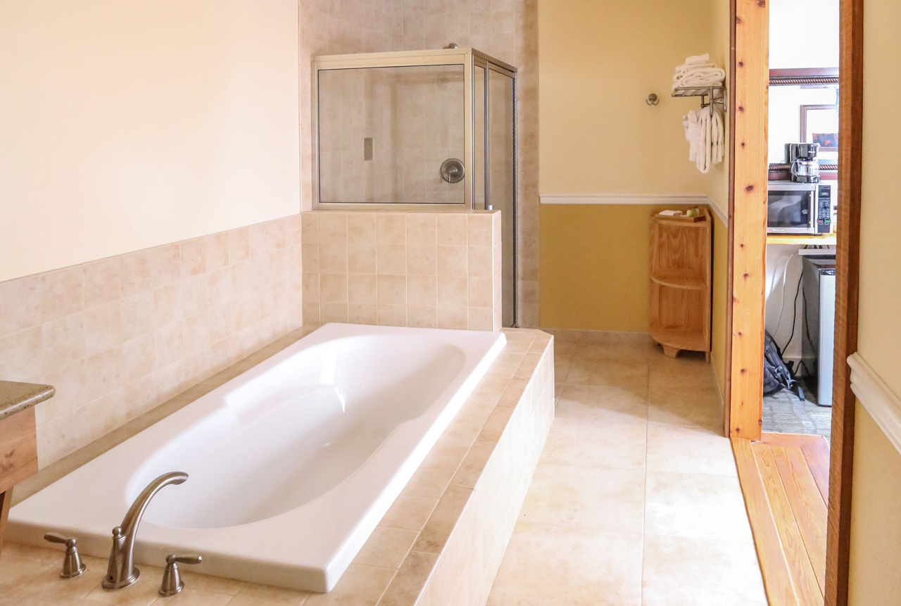 The Kalaloch Suite features a spacious bathroom with two-person tub and separate shower.