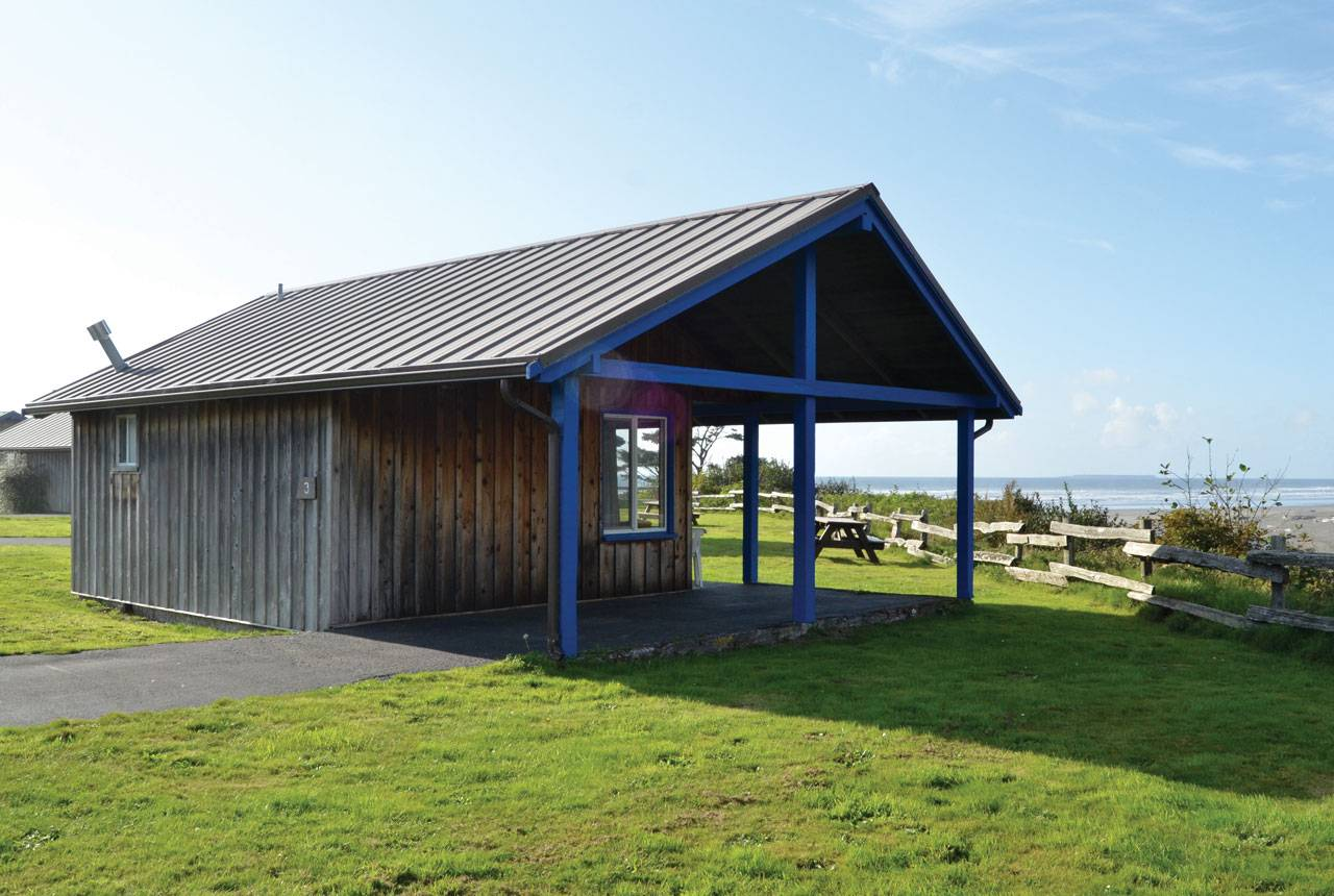 Pull right up to a Bluff Cabin at Kalaloch Lodge for covered parking and a view of the ocean.
