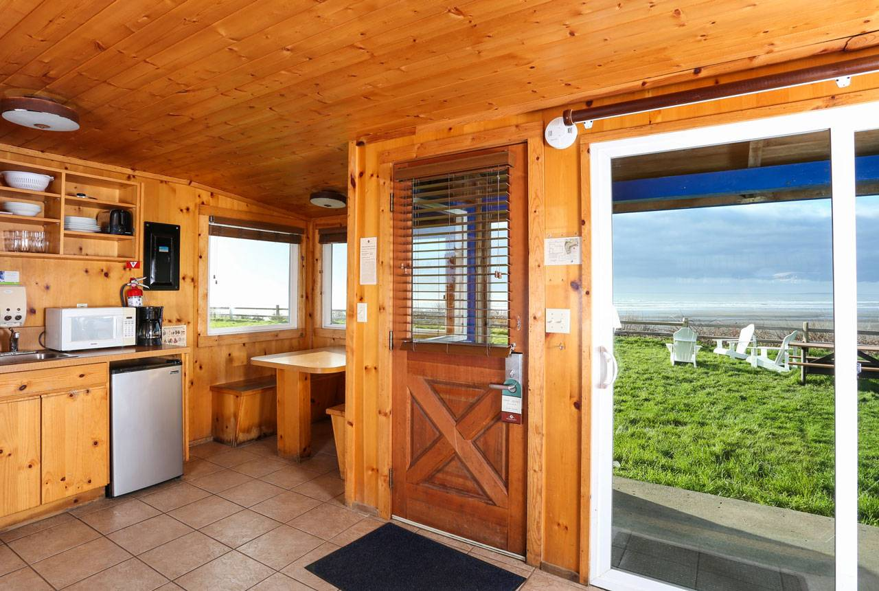 Kalaloch Lodge's gorgeous bluff cabins provide a front-row view of the ocean with kitchen/kitchenette & dining area.
