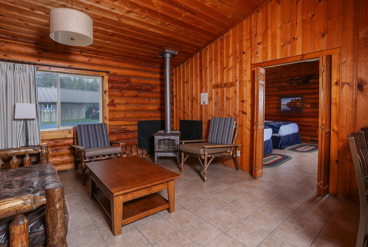 Duplex cabin at Kalaloch Lodge offers a comfortable area to relax by the wood stove, set apart from the sleeping area.