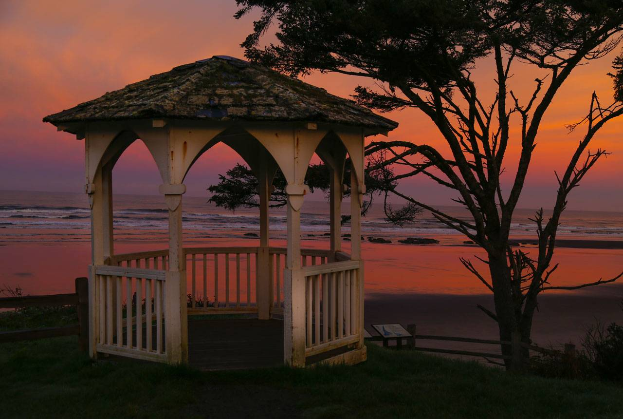 Enjoy a picture-perfect crimson sunset from the gazebo at Kalaloch Lodge.