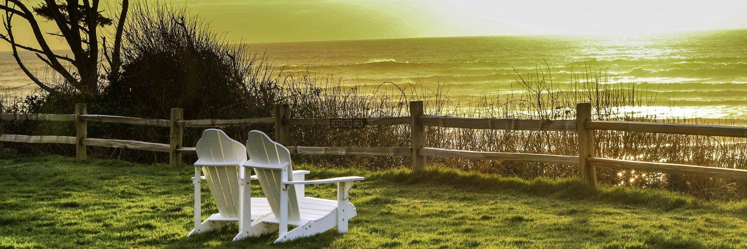 Two chairs sit overlooking sunset along Kalaloch Beach in Olympic National Park