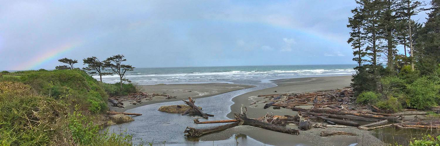 A rainbow stretches over Kalaloch Creek near Kalaloch Lodge in Olympic National Park