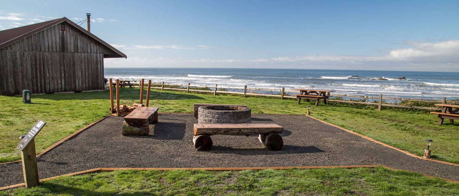 Share some warmth and meet your fellow travelers at Kalaloch Lodge's fire circle with a view overlooking the ocean.