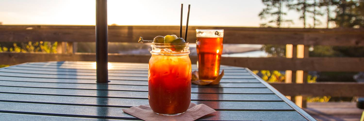 Enjoy a sip of something refreshing on the deck at Creekside Restaurant at Kalaloch Lodge.