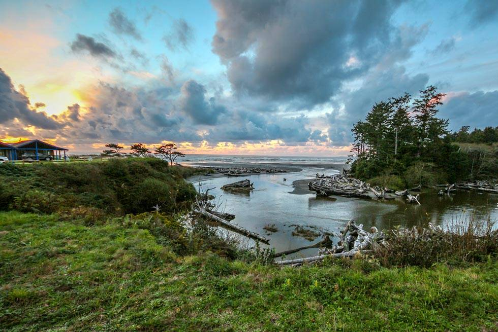 Enjoy the view from Kalaloch Lodge including Kalaloch Creek flowing out into the ocean at sunset.