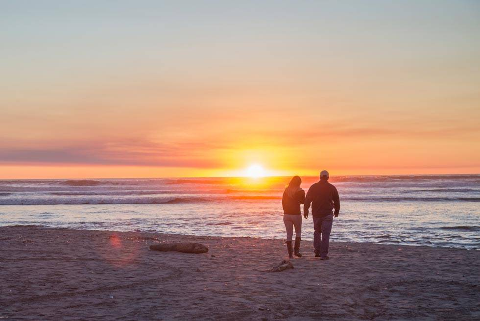 Enjoy a stroll down the beach in front of Kalaloch Lodge to watch the sunset.