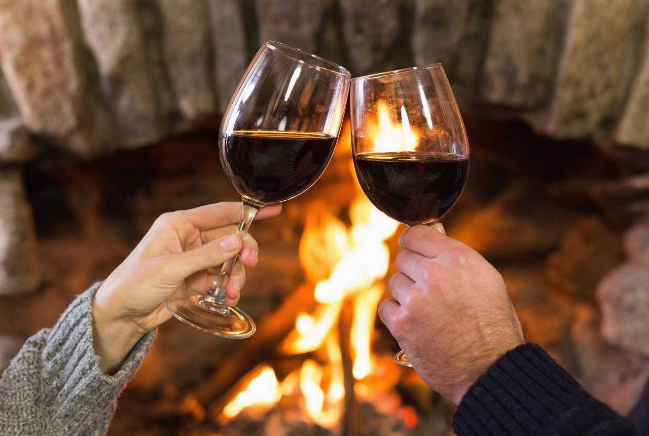 Cozy up by the fire with a glass of wine at Kalaloch Lodge